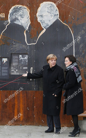"""Angela Merkel, Ewa Kopacz Poland's Prime Minister Ewa Kopacz,left, and German Chancellor Angela Merkel stand in front of a drawing depicting former Polish Prime Minister Tadeusz Mazowiecki,left,and former German Chancellor Helmut Kohl, during a visit of an exhibition to commemorate 25 years since a symbolic reconciliation between the two neighboring nations whose ties were marked by warfare in Krzyzowa, Poland, . Speaking on the occasion, Merkel stressed that security, freedom and the rule of law are made even more valuable today, when Ukraine's territorial integrity has been violated. """"We are aware that only together with Russia we can assure Europe's long-term security,"""" Merkel said"""