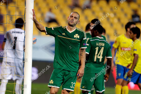 Panathinaikos' Mladen Petric touches the goal after missing a chance during an Europa League group E soccer match between Panathinaikos and Estoril at the Antonio Coimbra Da Mota stadium, in Estoril, Portugal, . Estoril defeated Panathinaikos 2-0