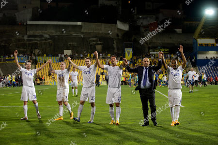Dynamo Moscow's Yuri Zhirkov, Alexander Buttner, Aleksei Kozlov, Kevin Kuranyi, coach Stanislav Cherchesov and Dmitri Zhivoglyadov, from left to right, celebrate with supporters at the end of the Europa League group E soccer match between Dynamo Moscow and Estoril at the Antonio Coimbra Da Mota stadium, in Estoril, Portugal, . Dynamo Moscow won 2-1