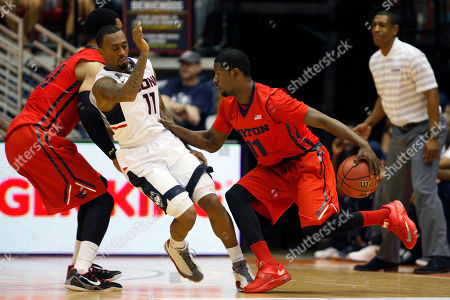 Scoochie Smith, Ryan Boatright Dayton guard Scoochie Smith, right, dribbles past UConn guard Ryan Boatright during a NCAA college basketball game in San Juan, Puerto Rico