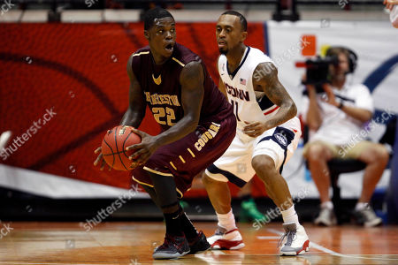 Ryan Boatright, Anthony Stitt Charleston guard Anthony Stitt looks to pass against the defense of UCONN guard Ryan Boatright, during an NCAA college basketball game in San Juan, Puerto Rico
