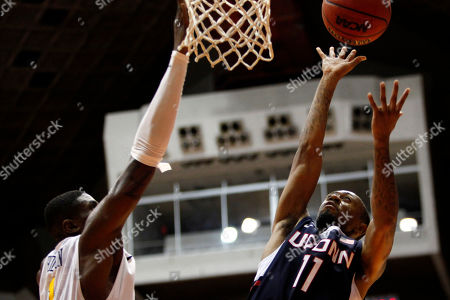 Ryan Boatright, Jonathan Holton UConn guard Ryan Boatright, right, goes to the basket against West Virginia forward Jonathan Holton during a NCAA college basketball game in San Juan, Puerto Rico