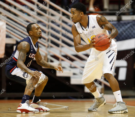Ryan Boatright, Terrence Phillip UConn guard Ryan Boatright, left, pressures West Virginia guard Terrence Phillip during a NCAA college basketball game in San Juan, Puerto Rico