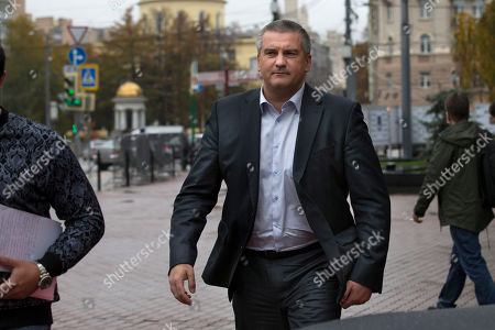 Sergei Aksyonov Crimean leader Sergei Aksyonov walks to his car after a news conference in Moscow, Russia, . Aksyonov, the Kremlin-backed leader of Crimea, which was annexed by Russia in March, spoke in a news conference in Moscow about social and economic problems the region is facing