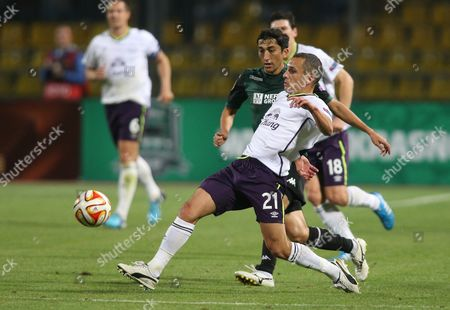 Odil Ahmedov, Leon Osman Krasnodar's Odil Ahmedov fights for the ball with Everton's Leon Osman, front, during the Europa League Group H soccer match between Krasnodar and Everton in Krasnodar, Russia