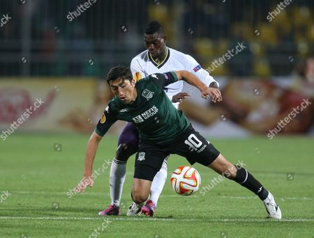 Odil Ahmedov, Christian Atsu Krasnodar's Odil Ahmedov, front, fights for the ball with Everton's Christian Atsu during the Europa League Group H soccer match between Krasnodar and Everton in Krasnodar, Russia