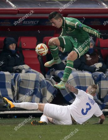 Christos Donis, Alexander Büttner Panathinaikos' Christos Donis, top, jumps over Dinamo Moscow's Alexander Buttner for the ball during the Europa League Group E soccer match between Dynamo Moscow and Panathinaikos at the Arena Khimki stadium in Moscow, Russia