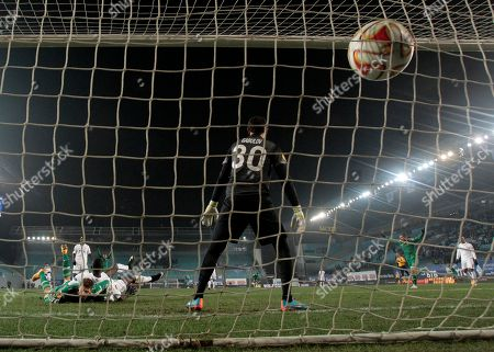 Vladimir Gabulov Dinamo Moscow's goalkeeper Vladimir Gabulov, back to camera, fails to stop a shot by Panathinaikos's Abdul AjagunInjured during the Europa League Group E soccer match between Dynamo Moscow and Panathinaikos at the Arena Khimki stadium in Moscow, Russia