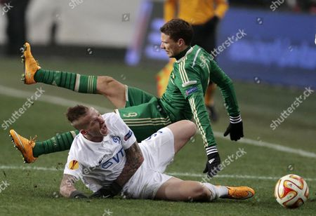 Alexander Büttner, Marcus Berg Dinamo Moscow's Alexander Buttner and Panathinaikos' Marcus Berg, top, fall during a challenge in the Europa League Group E soccer match between Dynamo Moscow and Panathinaikos at the Arena Khimki stadium in Moscow, Russia
