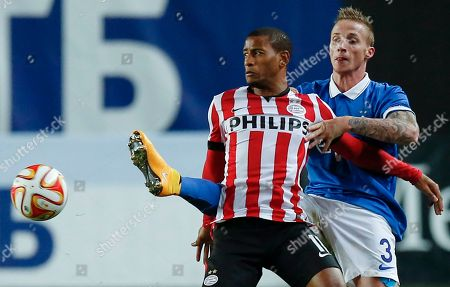 Alexander Buttner, Luciano Narsingh Dynamo's Alexander Buttner, right, fights for a ball with PSV's Luciano Narsingh during the Europa League Group E soccer match between Dynamo Moscow and PSV at the Arena Khimki stadium in Moscow, Russia