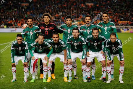 Front row from left, Mexico's Jose Juan Vazquez, Andres Guardado, Paul Aguilar, Hector Herrera, Adrian Aldrete and Javier Hernandez, back row from left, Carlos Vela, goalkeeper Guillermo Ochoa, Miguel Angel Herrera, Oswaldo Alanis and Diego Reyes pose for a team photo before the international friendly soccer match between the Netherlands and Mexico at ArenA stadium in Amsterdam, Netherlands