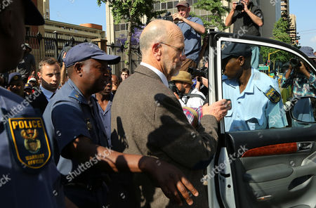 Oscar Pistorius Oscar Pistorius, far left, follows his uncle Arnold Pistorius, right, as they leave the high court in Pretoria, South Africa, . Oscar Pistorius faces sentencing this week in a South African court after being convicted of culpable homicide for killing girlfriend Reeva Steenkamp