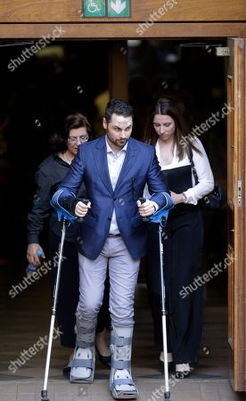 Stock Photo of Oscar Pistorius Oscar Pistorius's bother Carl Pistorius assisted by sister Aimee Pistorius, right, leave the high court in Pretoria, South Africa, . Following the testimony hearing, Judge Thokozile Masipa is expected to announce Pistorius' sentence on Tuesday after she found him guilty last month of culpable homicide for negligently killing Steenkamp, but acquitted him of murder
