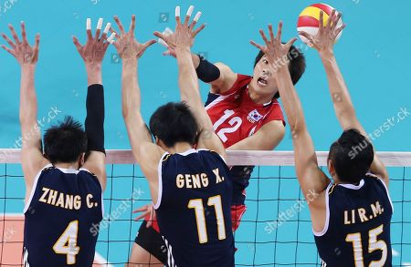 Jeon Kwan-gin, Zhang Chen, Geng Xin, Li Runming South Korea's Jeon Kwan-gin, top, spikes against China's Zhang Chen, left, Geng Xin, center, and Li Runming, right, during the men's volleyball bronze match against South Korea at Songnim Gymnasium at the 17th Asian Games in Incheon, South Korea