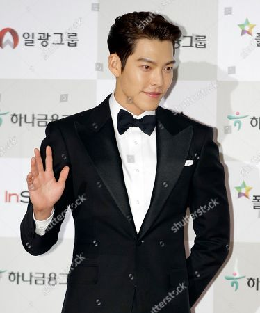 South Korean actor Kim Woo-bin poses for a photo call during the Daejong Film Awards in Seoul, South Korea