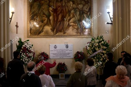 People visit the tombstone of Maria del Rosario Cayetana Fitz-James Stuart y Silva, the Duchess of Alba in the Gipsy Chuch in Seville, Spain, . The Duchess of Alba, who was one of Spain's wealthiest and most colorful aristocrats and listed as the world's most titled noble, died Thursday at the age of 88. Twice-widowed, the fabulously wealthy Duchess raised eyebrows in 2011 when at the age of 85 she wed her third husband, a civil servant 25 years her junior