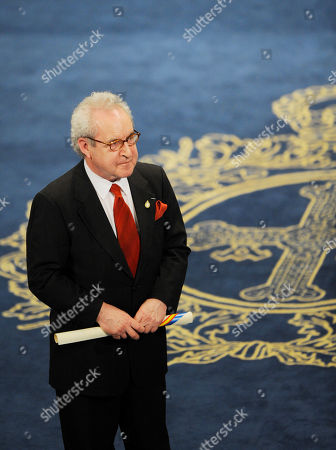John Banville Writer John Banville holds his Prince of Asturias Prize for Literature received from Spain's King Felipe VI at a ceremony in Oviedo, northern Spain