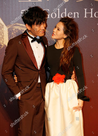 Stock Image of Annie Yi, Qin Hao Taiwanese singer and actress Annie Yi, right, and her Chinese actor fiance Qin Hao pose on the red carpet at the 51st Golden Horse Awards in Taipei, Taiwan, . They are guests at this year's Golden Horse Awards, one of the Chinese-language film industry's biggest annual events