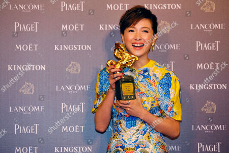 """Regina Wan Taiwanese actress Regina Wan holds her awards and poses for media for Best Supporting Actress at the 51st Golden Horse Awards in Taipei, Taiwan, . Wan won for the film """"Paradise in Service"""" at this year's Golden Horse Awards -the Chinese-language film industry's biggest annual events"""