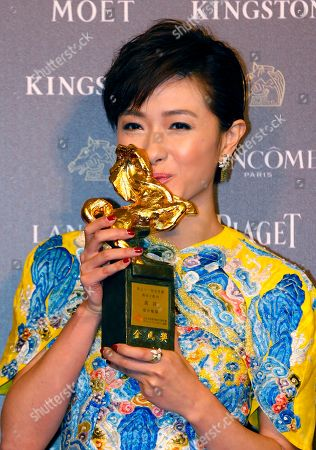 """Regina Wan Taiwanese actress Regina Wan kisses her trophy for Best Supporting Actress at the 51st Golden Horse Awards in Taipei, Taiwan, . Wan won the award for the film """"Paradise in Service"""