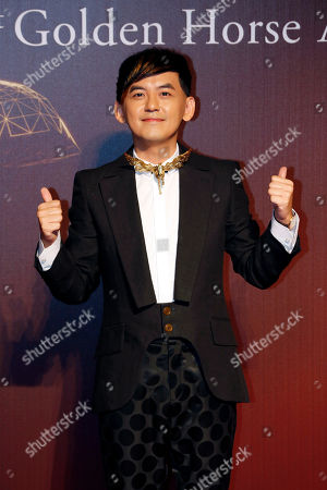 Stock Image of Mickey Huang Taiwanese actor Mickey Huang poses on the red carpet at the 51st Golden Horse Awards in Taipei, Taiwan, . Huang is the host at this year's Golden Horse Awards, one of the Chinese-language film industry's biggest annual events