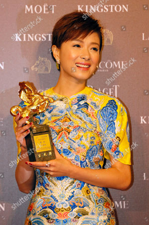"""Regina Wan Taiwanese actress Regina Wan displays her award for Best Supporting Actress at the 51st Golden Horse Awards in Taipei, Taiwan, . Wan won for the film """"Paradise in Service"""" at this year's Golden Horse Awards -the Chinese-language film industry's biggest annual events"""