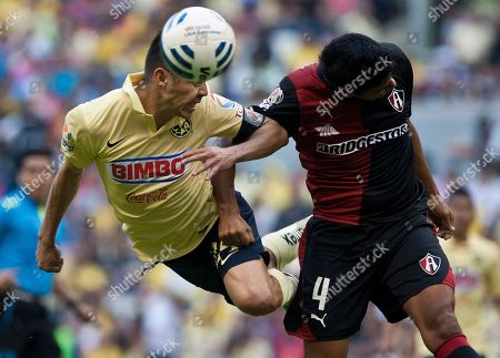 Oribe Peralta, Luis Venegas America's Oribe Peralta, left, heads the ball against Luis Venegas of Atlas during a Mexican soccer league match in Mexico City