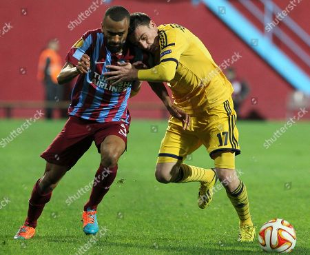 Stock Photo of Ose Bosingwa, Sergiy Pshenychnykh Trabzonspor's Jose Bosingwa, left, tries to get away from Sergiy Pshenychnykh of Metalist, during their Europa League Group L soccer match at Avni Aker Stadium in Trabzon, Turkey
