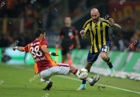 Veysel Sari, Raul Meireles Galatasaray's Veysel Sari, left, and Raul Meireles of Fenerbahce fight for the ball during their Turkish League soccer derby match at the TT Arena stadium in Istanbul, Turkey