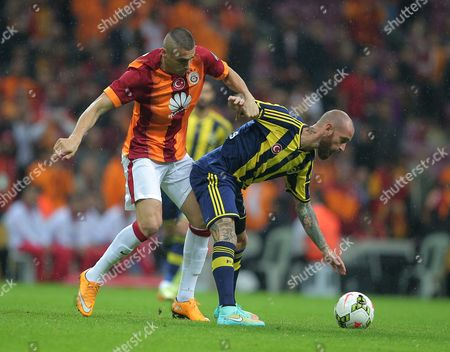 Burak Yilmaz, Raul Meireles Galatasaray's Burak Yilmaz, left, and Raul Meireles of Fenerbahce fight for the ball during their Turkish League soccer derby match at the TT Arena stadium in Istanbul, Turkey