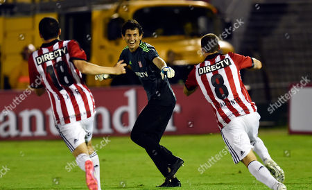 Stock Picture of Hilario Navarro Goalie Hilario Navarro of Argentina's Estudiantes de la Plata, center, celebrates with teammates after stopping a penalty shot at the end of a Copa Sudamericana soccer match against Uruguay's Penarol in Montevideo, Uruguay, . Estudiantes defeated Penarol in a penalty shootout