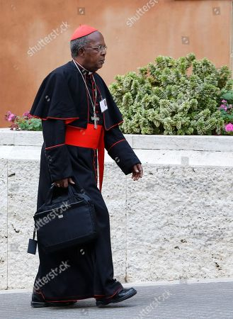 Stock Image of On, Cardinal Francis Arinze arrives for a consistory at the Vatican. Once touted as the leading candidate for an African pope, the 82-year-old Arinze remains something of the eminence grise of the African prelates who have made their mark at this synod by holding fast to Catholic doctrine and rejecting attempts by more liberal prelates to introduce wiggle room in Catholic ministry to gays and divorcees