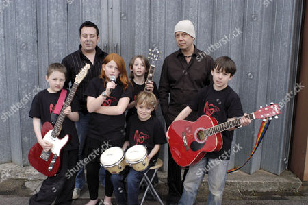 Rok Skool band 'Crikey Mikey' L-R Tom Coxhead, Izzy Cotterill, Josh Peters, Andrew Spencer and Josh Stirling, with Leon and Hereward Kaye