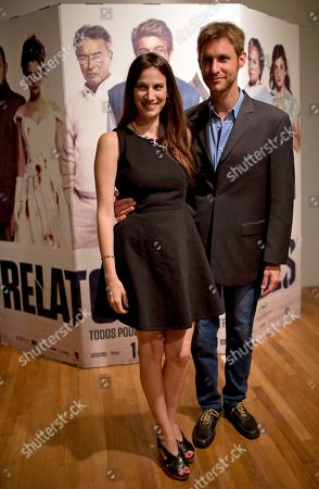 """Film director Damian Szifron, right, and his wife, actress Maria Marull, pose for pictures during a press conference about their film """"Relatos Salvajes,"""" or Wild Tales one day after it earned an Oscar nomination for best foreign-language film, in Buenos Aires, Argentina, . The film includes six independent stories about people who lose control in stressful situations, and has become the most-viewed domestic film of all time in Argentina"""