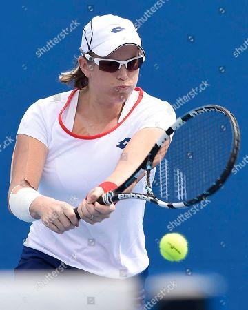 Romina Oprandi of Switzerland makes a backhand return to Denisa Allertova of the Czech Republic during their first round match at the Australian Open tennis championship in Melbourne, Australia