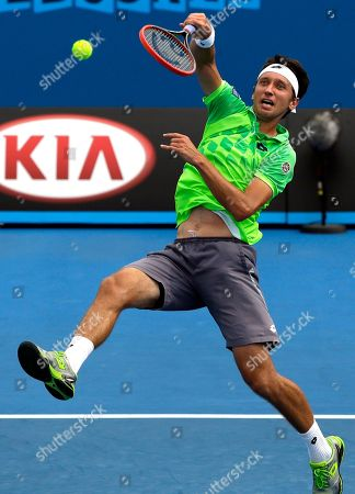 Sergiy Stakhovsky of Ukraine hits a smash to David Ferrer of Spain during their second round match at the Australian Open tennis championship in Melbourne, Australia