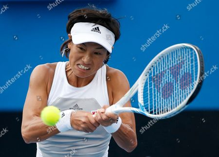 Kimiko Date-Krumm of Japan makes a backhand return to Anna Tatishvili of the U.S. during their first round match at the Australian Open tennis championship in Melbourne, Australia