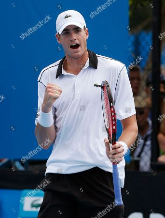 Stock Image of John Isner of the U.S. celebrates during his first round match against Taiwan's Jimmy Wang at the Australian Open tennis championship in Melbourne, Australia