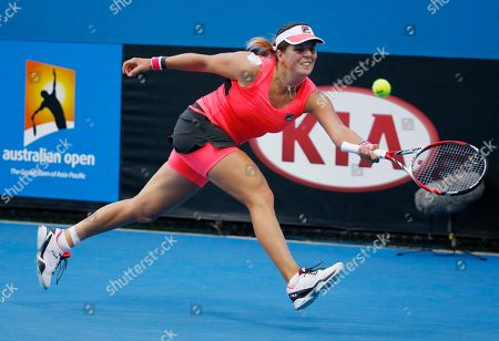 Anna Tatishvili of the U.S. makes a forehand return to Kimiko Date-Krumm of Japan during their first round match at the Australian Open tennis championship in Melbourne, Australia