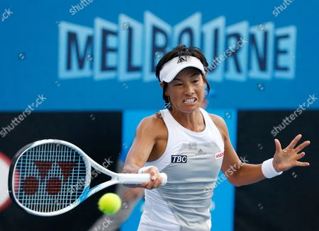 Kimiko Date-Krumm of Japan makes a forehand return to Anna Tatishvili of the U.S. during their first round match at the Australian Open tennis championship in Melbourne, Australia
