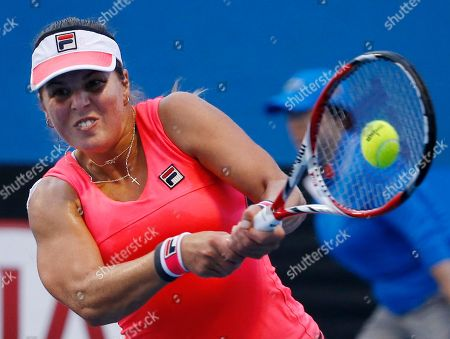 Anna Tatishvili of the U.S. makes a backhand return to Kimiko Date-Krumm of Japan during their first round match at the Australian Open tennis championship in Melbourne, Australia