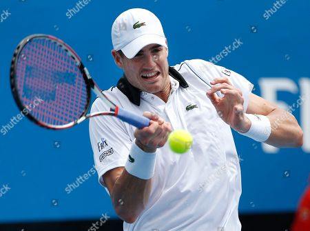 John Isner of the U.S. makes a forehand return to Taiwan's Jimmy Wang during their first round match at the Australian Open tennis championship in Melbourne, Australia