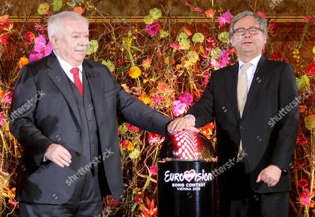 Michael Haeupl, Alexander Wrabetz Michael Haeupl, Mayor of Vienna, and the Director General of the Austrian state television ORF Alexander Wrabetz, from left, push the start button for the countdown of the Eurovision Song Contest at the city hall in Vienna, Austria, . Vienna will host the Song Contest in May 2015