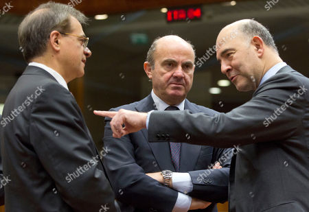 Pierre Moscovici, Gikas Hardouvelis, Luis de Guindos European Commissioner for Economic and Monetary Affairs Pierre Moscovici, right, speaks with Greek Finance Minister Gikas Hardouvelis, left, and Spanish Economy Minister Luis de Guindos, center, during a meeting of EU finance ministers at the EU Council building in Brussels on . France is urging its EU partners to step up the fight against terror financing and will propose new measures to make sure transactions are more transparent