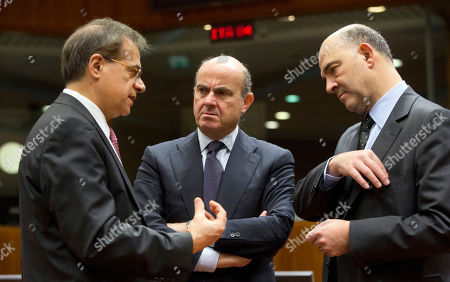 Gikas Hardouvelis, Luis de Guindos, Pierre Moscovici Greek Finance Minister Gikas Hardouvelis, left, speaks with Spanish Economy Minister Luis de Guindos, center, and EU Commissioner for Economic and Monetary Affairs Pierre Moscovici during a meeting of EU finance ministers at the EU Council building in Brussels on . France is urging its EU partners to step up the fight against terror financing and will propose new measures to make sure transactions are more transparent