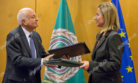 Federica Mogherini, Nabil Al-Araby Secretary General of the Arab League Nabil Al-Araby, left, exchanges booklets with European Union High Representative Federica Mogherini after signing a cooperation agreement after a meeting of EU foreign ministers in Brussels on . The European Union is calling for an anti-terror alliance with Arab countries to boost cooperation and information sharing in the wake of deadly attacks and arrests across Europe linked to foreign fighters