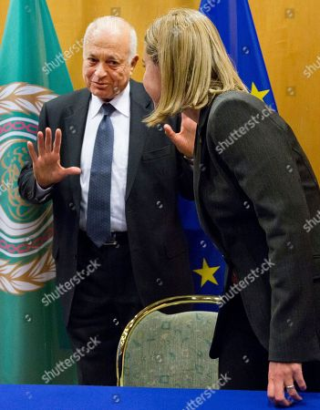 Federica Mogherini, Nabil Al-Araby Secretary General of the Arab League Nabil Al-Araby, left, gestures while speaking with European Union High Representative Federica Mogherini prior to signing a cooperation agreement after a meeting of EU foreign ministers in Brussels on . The European Union is calling for an anti-terror alliance with Arab countries to boost cooperation and information sharing in the wake of deadly attacks and arrests across Europe linked to foreign fighters