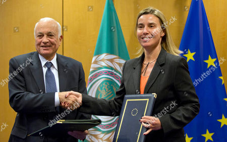 Federica Mogherini, Nabil Al-Araby Secretary General of the Arab League Nabil Al-Araby, left, shakes hands with European Union High Representative Federica Mogherini after signing a cooperation agreement after a meeting of EU foreign ministers in Brussels on . The European Union is calling for an anti-terror alliance with Arab countries to boost cooperation and information sharing in the wake of deadly attacks and arrests across Europe linked to foreign fighters