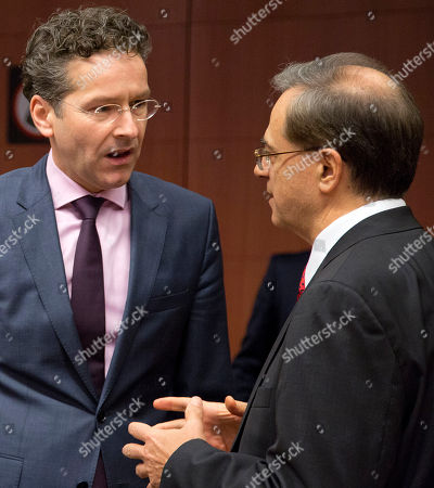Jean-Claude Juncker, Gikas Hardouvelis Dutch Finance Minister Jeroen Dijsselbloem, left, speaks with outgoing Greek Finance Minister Gikas Hardouvelis during a meeting of the eurogroup at the EU Council building in Brussels on . Even before Eurozone nations could fully assess the impact of the Greek election victory of a firebrand left-winger on their shaky shared currency, Alexis Tsipras moved with stunning speed to form the anti-austerity government that many feared. Still, reactions from the other nations sharing the euro echoed compromise more than imminent chaos