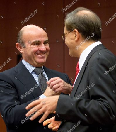 Luis de Guindos, Gikas Hardouvelis Spanish Economy Minister Luis de Guindos, left, speaks with outgoing Greek Finance Minister Gikas Hardouvelis during a meeting of the eurogroup at the EU Council building in Brussels on . Even before Eurozone nations could fully assess the impact of the Greek election victory of a firebrand left-winger on their shaky shared currency, Alexis Tsipras moved with stunning speed to form the anti-austerity government that many feared. Still, reactions from the other nations sharing the euro echoed compromise more than imminent chaos
